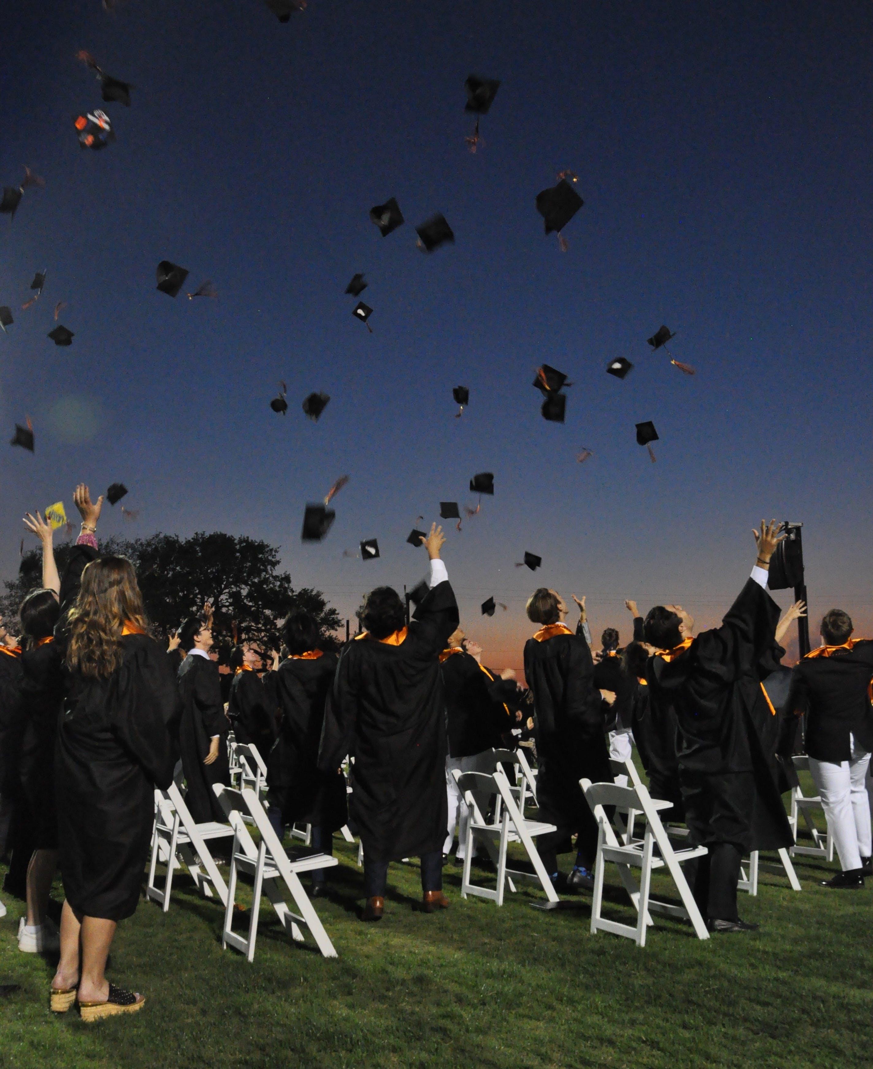 Graduation 2021 hats in the air.jpg