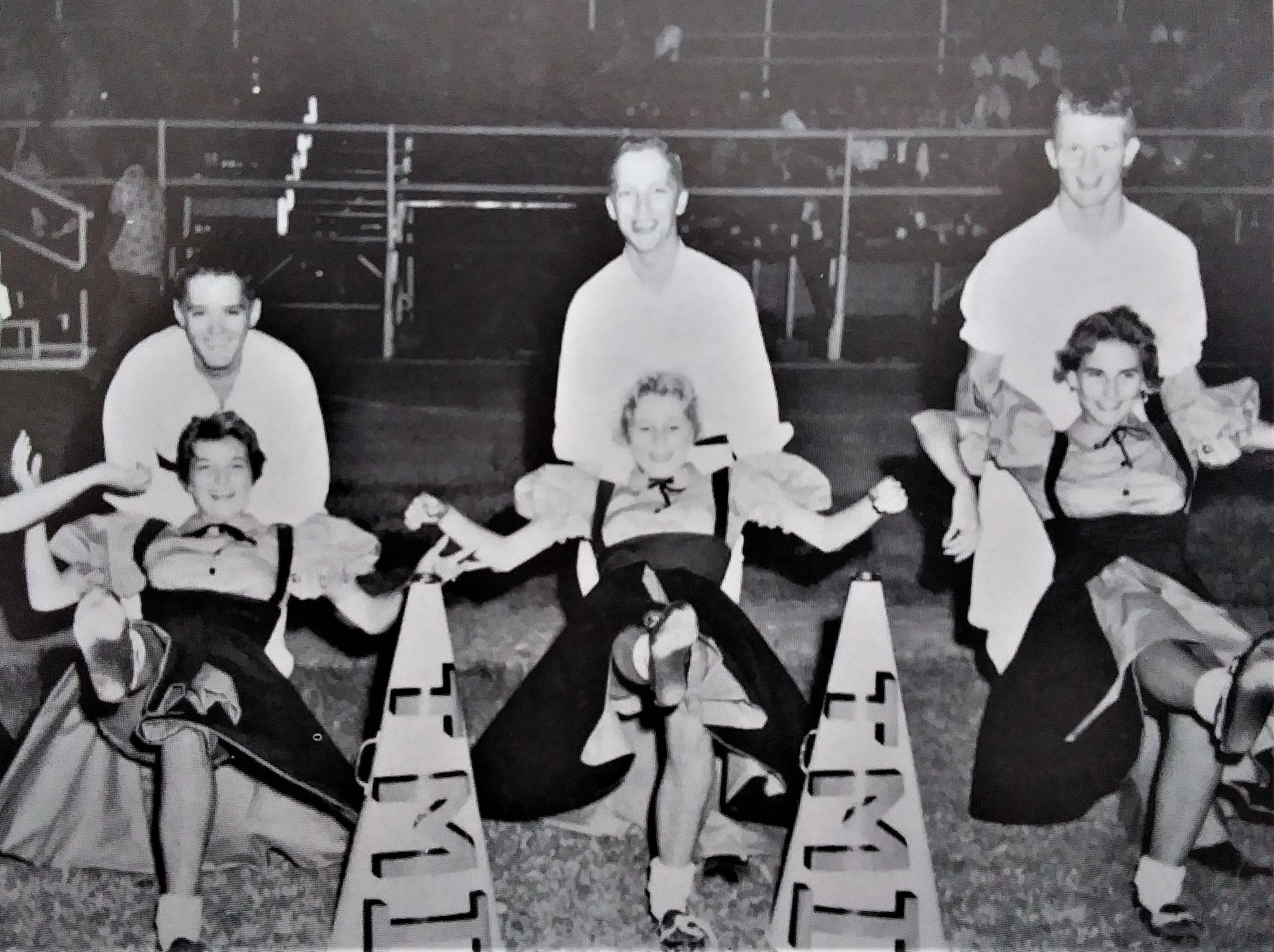 Olive Anne Musgrave cheerleader 1960 yearbook.jpg