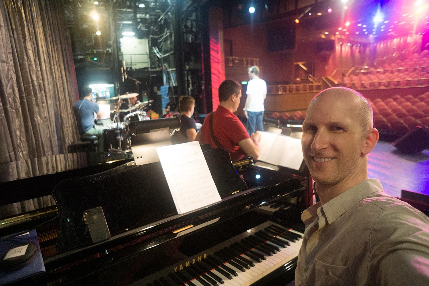 Vancouver Voice Teacher and Professional Musician Courtenay Ennis at Grand Piano in Show Rehearsal in Large Theatre.jpg